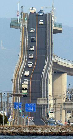 Eshima Ohashi Bridge, Japan The bridge looks more like a roller coaster than a road. The Eshima Ohashi Bridge in Japan rises so. Places To Travel, Places To See, Scary Places, Places Around The World, Around The Worlds, Scary Bridges, Dangerous Roads, Mario Kart, Roller Coaster