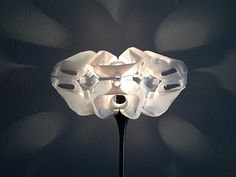 Milk Shell lampshade by Gilbert de Rooij. First there was the 'Milkflower' lampshade and now another upcycle design. This time 'Milk Shell', a lampshade made out of plastic milk bottles using the top part. A nice open design and playful shadows.    More information at upcycleDZINE website ! Idea... #Lamp, #Lampshade, #Milk, #Plastic