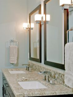 cool shades of blue and dark espresso wood tones. Custom vanity is a free standing piece. Granite counters, recycled glass tile complete the look.