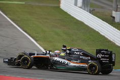 Fernando Alonso, McLaren MP4-31 and Sergio Perez, Sahara Force India F1 VJM09…