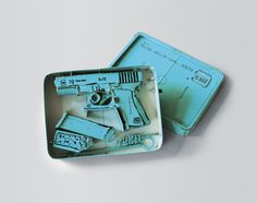 Tom Sachs    Tiffany Glock (Model 19)    1995  cardboard, thermal adhesive, ink  2.5 x 6.5 x 9 inches