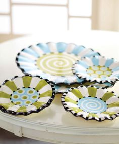 Ceramic plates come in four playful styles featuring ruffled rims and hand painted designs. Delightful for serving up your favorite treats in style to friends and family. Each style sold separately. Part of Mud Pie's Ruffles Collection.  Dressed up in Ruffles: A girl's love affair with ruffles grows up but never goes away. She likes the flair they bring to everything, including bakers, bowls and trays!