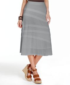 Love this diagonally styled grey skirt.