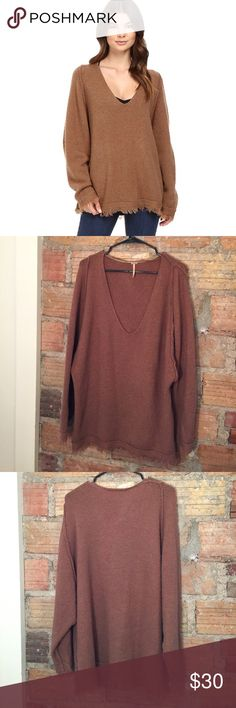 Free People irresistible fringe trim sweater Oversized wool-blend sweater gives you the cozy look you've been wanting all season. Fringe trim at cuffs and hemline. Has brown fuzzy pilling! Love this sweater!  -V-neckline. -Long sleeve design. -Straight hemline. 65% wool, 22% nylon, 11% linen, 2% spandex. -Hand wash and dry flat. Free People Sweaters Crew & Scoop Necks