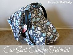 Easy Car Seat Canopy Tutorial: this one has the option of a front window to see the baby through.