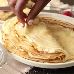 Breakfast Recipes Easy Crepe Recipe - Light, tender and slightly sweet crepes that makes for a fancy breakfast filled with your favorite fresh fruit, Nutella or dusted off with powdered sugar and whipped cream on the side. Simply, easy, tasty and fancy!