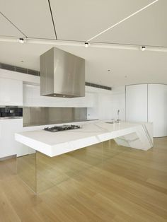 Crazy minimal kitchen with transparent island base