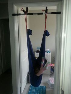 Home made lycra swing using pull up bar and lycra spandex and a bit of rope. Crash mat underneath and supervision . Sensory Tools, Sensory Activities, Games For Kids, Diy For Kids, Kid Games, Kids Indoor Gym, Trampoline Swing, Diy Pull Up Bar, Crash Mat