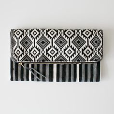 Neutral shades, intricately hand woven Tribe Alive clutch. Made in Guatemala.