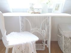 Look... a sewing machine table painted white... I LOVE it!
