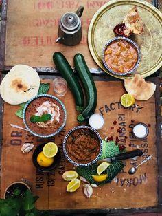 Lebanese food flat lay zucchini lemon pita bread pomegranate