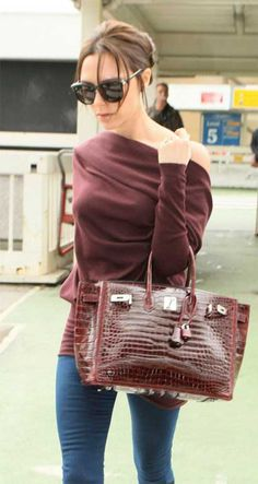 celebrities street fashion styles; Victoria Beckham has a handbag collection valued in excess of $2,000,000.00 dollar US…and her she has a HERMES Kelly Bag $30,000.00 handbag made of genuine burgundy died Crocodile Alligator Caiman leather