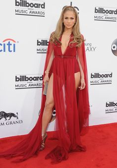 You might think that Jennifer Lopez's streak of dresses with necklines down to her belly button and slits up to her thighs started with that famous Versace green dress she wore to the Grammys in the '90s, but let us tell you that after intense research, we've come to the conclusion the naked dress trend was started by J Lo much, much earlier.