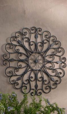 Grandin Road saved to Garden by the ornamental ironwork of the New Orleans' Garden District, our Gracie Iron Wall Art boasts scrolled iron details that create playful negative spaces with a central flower medallion.