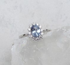 Ice Blue Sapphire Diamond Halo Engagement Ring by PristineJewelry, $1170.00