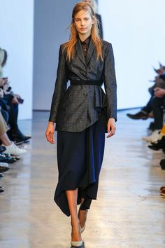 Obviously Mr. Theyskens is better at designing for others than for himself. Love the jacket's drape and the skirt, good colour.