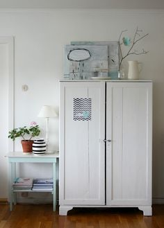 cabinet or lockers to store backpacks, etc. in instead of open hooks.