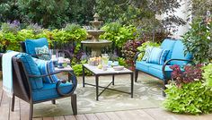 Furnished Deck with a Fountain.  Great patio color. Download Lowe's Creative Ideas free on the Apple Newsstand. Outdoor furniture.