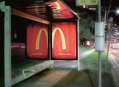 "McDonalds – Night  Agency: DDB Sydney  Incredibly smart from McDonalds who use the bus shelter's reflection to complete its logo and help you read the tagline (It says ""Open all night""). via http://www.simplyzesty.com/"