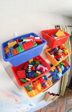 Lego storage - hang baskets or buckets with lips on the wall with Command hooks