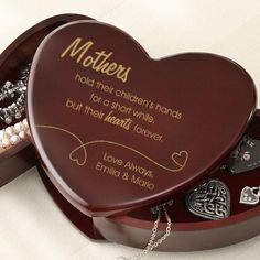"Personalized Heart Shaped Wooden Jewelry Box for Mom - ""Mothers hold their children's hands for a short while, but their hearts forever.""  Add your own closing message underneath.   $28.95"
