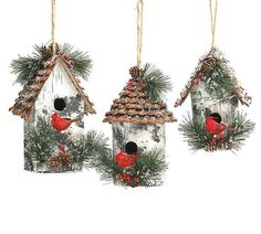 Rustic birdhouse ornaments feature vivid cardinals and fluffy greens with natural jute hangers. With textured pine cone roof, these large ornaments make thoughtful holiday gifts... or unique additions
