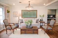Here, painted shiplap walls add subtle texture to this open, airy living room.