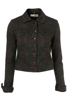 Worn by teenage vamp Caroline Forbes on the CW's hit show, The Vampire Diaries, actress Candice Accola wears a Floral Moto Denim Jacket from high street retailer, TopShop. During the episode titled Sacrifice, Caroline finds a horrifying bit of...