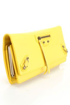 Paper Wand Clutch In Yellow  A bright yellow I would love to have as an accent in the winter time, well pretty much anytime