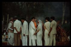 Rajiv Gandhis Funeral: 1991: The family of the late prime minister Rajiv Gandhi watches his funeral pyre burn on May 24 1991. He was assassinated by a suicide bomber sympathetic to the cause of the Tamil Tigers