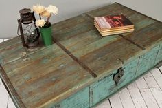 What a great combination of function and fashion! Salvaged vintage Indian turquoise green wedding chest made into trunk coffee table. The reclaimed body is a part of a killer antique dowry chest and has gorgeous patina and detail. Original iron work faces the coffee table/chest. This table has been hand constructed.  Provides plenty of storage for games, memories, toys, shoes, music, etc.  Rustic yet sturdy and functional! A one-of-a-kind conversation piece that you can build a room around…