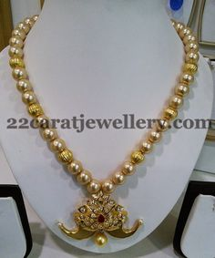 Jewellery Designs: Tiger Claw Locket with Pearls Set