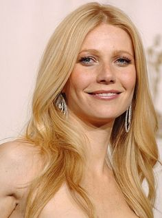 Paltrow's carefree waves start with a dollop of body-building mousse, like Living Proof Full Thickening Mousse, at the crown. Flip the head upside down, and blow-dry. Take a one-and-a-half-inch curling iron to large sections of hair, curving away from the face. Tease a little bit at the crown, and lightly mist with hair spray.