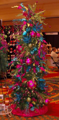 These are the colors on my tree at home!!   this is sort of what I have in mind for our fake white Christmas tree...very Dr. Seuss inspired to me...all other decor would have to be super simple since this is so loud!