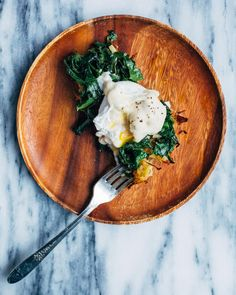 Kale eggs Florentine served over muffin tin hash browns and topped with rich mornay sauce.