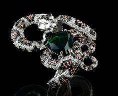 750 white gold, 4.90 ct tourmaline, black diamonds, cognac diamonds, enamel.