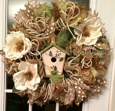Green and burlap deco mesh wreath with birdhouse and magnolias
