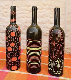 Paint your glass bottles to turn them into decorations.