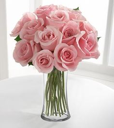 Medium Stem Pink Rose Bouquet - 12 Stems with Vase. She said it could be mostly baby's breath with a rose here and a rose there. Vases will be taller.