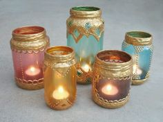 Moroccan lanterns from glass jars. Painting the inside was tougher than anticipated, but it turned out well.