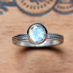 Rainbow moonstone ring with braided wheat band.  recycled sterling silver  by metalicious, $240.00