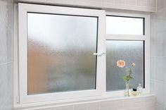An open white uPVC Tilt Turn window viewed from a bathroom