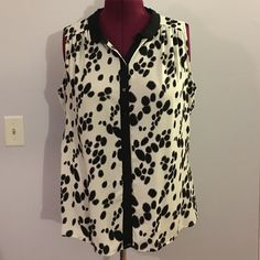 "Worthington Black & White Polka Dot Sleeveless Top Up for grabs is this top from Worthington Woman. It is a size 2X and measures 29"" from shoulder to hem and has a 52"" bust. This blouse buttons up the front and has a micro peter pan collar. It has black splotch polka dot print on a white background. This lightweight top has been gently worn and is in excellent condition. Worthington Tops Blouses"
