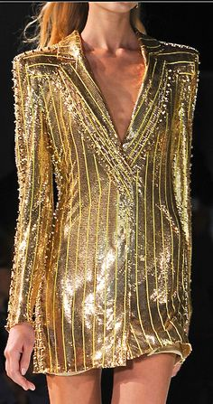 Versace gold women's wear - gold never goes out of syle. The world has run on it for thousands of years.