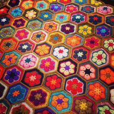 Almost there!! Golden tassels on the edges to finish off this colourful garden of African flowers!! #TMBstudio #crochetdesign #crochet #crocheting #crochetaddict #crochetersofinstagram #instacrochet #yarnlove #happytime #yarnaddict #africanflower #happy #colors #crochetblanket #babyblanket #throws #crochetthrow #wip #workinprogress by tothemoonandbackstudio