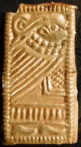 Guldgubber depicting a woman with a necklace.