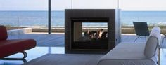 "The Twilight II is the world's first see-thru indoor/outdoor gas fireplace. Enjoy the fire all year long, and from either side. An advanced design exceeds both window and gas fireplace standards, and rugged construction ensures impressive, consistent performance. 36"" viewing areas Unique indoor/outdoor viewing Many finishing and installation options; no venting required."