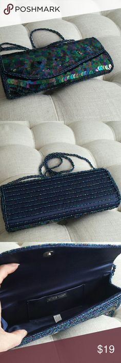 Bijoux Turner clutch This is just a beautiful bag all sequins and Tiny beads what is 9.5 x 4 inches has a beaded handle the drop of approximately 21 inches that is never been used does having a sequin 2 sequins actually that are a little bent  Fixable and not very noticeable  never used  Excellent condition Bags Clutches & Wristlets