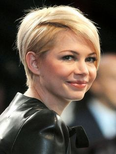 Close cropped with dramatic bangs - This cut is very dramatic, with swooping long bangs that help to elongate a round face. It really makes a statement! -