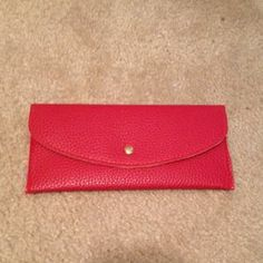 I just discovered this while shopping on Poshmark: NWT Red wallet. Check it out!  Size: OS